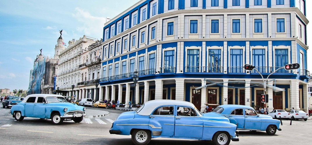 Shades of blue in the bustling streets of Havana. Credit: Galli Levy