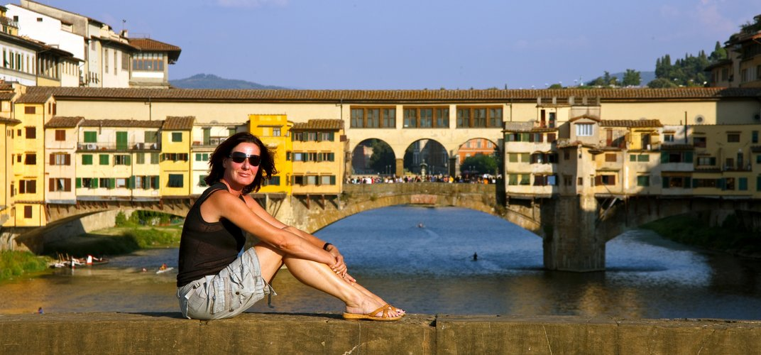 Sightseeing in Florence with Ponte Vecchio in background
