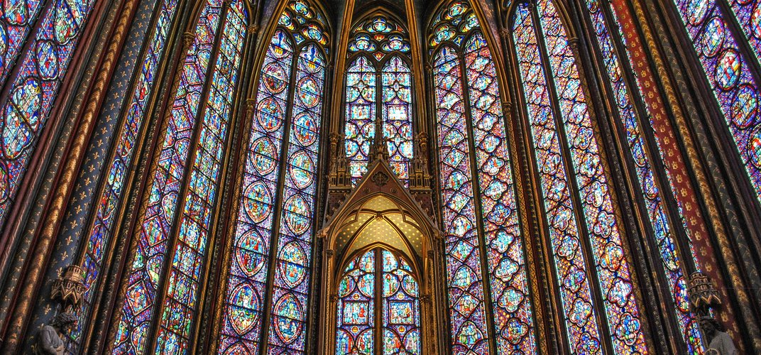 Stained glass windows in a medieval chapel, Paris. Credit: Vincent Cheng