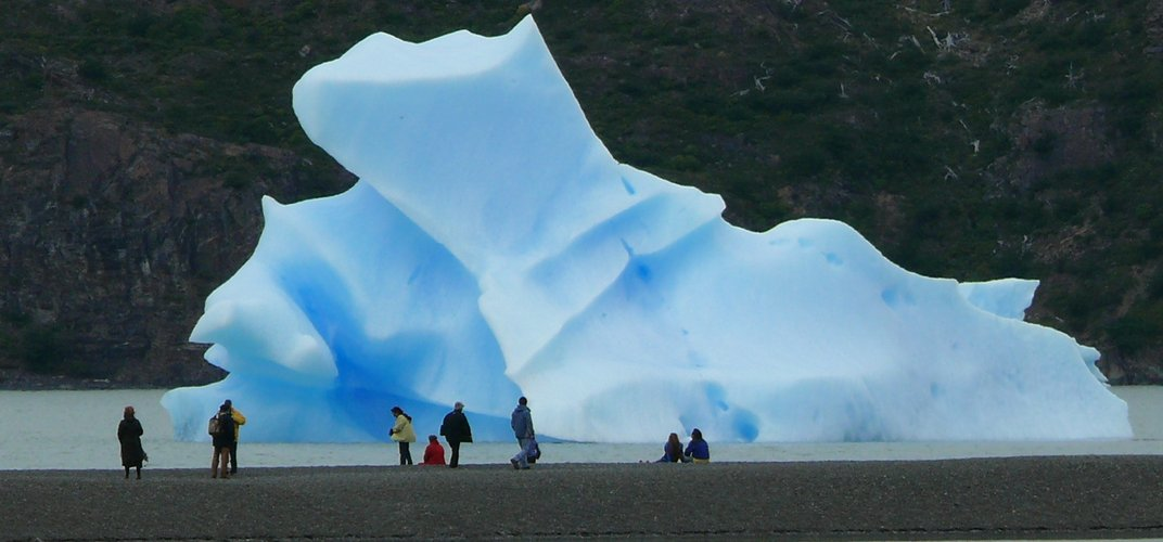 Travelers admire surreal ice formations. Credit: Peter Kibbee