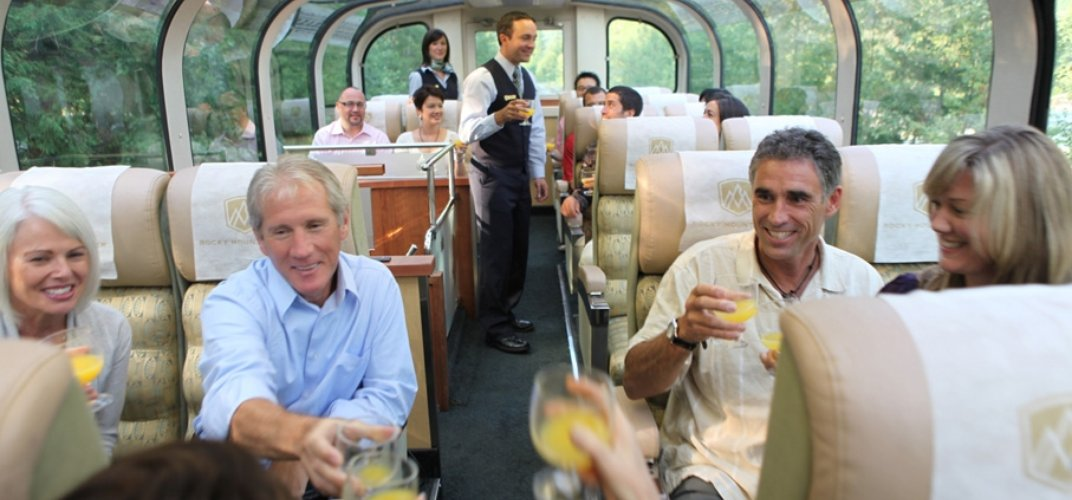 Travelers enjoying time in the observation car