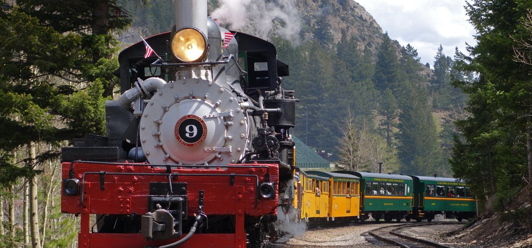 Train traveling through spectacular scenery aboard the Georgetown Loop Railroad
