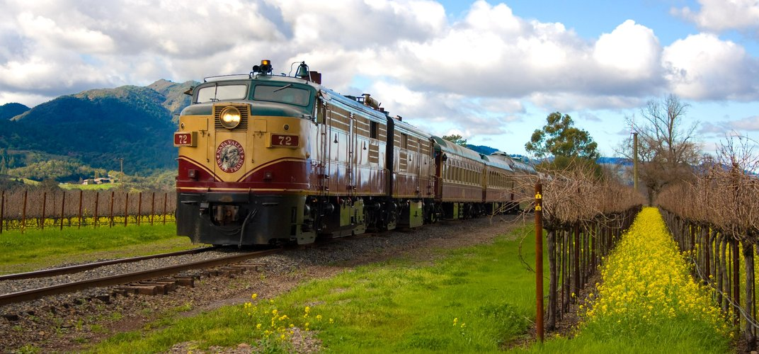 The Napa Valley Wine Train passing through a vineyard. Credit: Napa Valley Wine Train