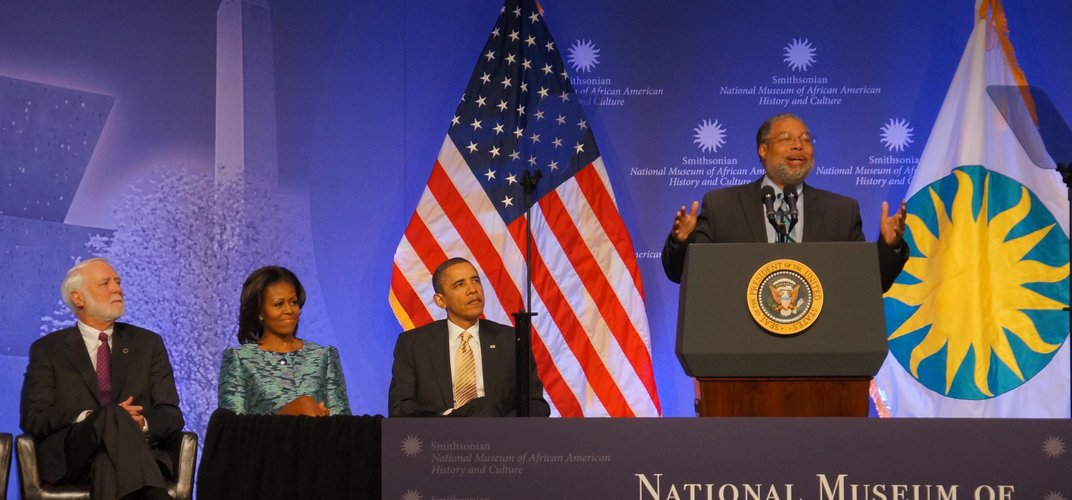 Lonnie Bunch, director of NMAAHC, speaking at museum's groundbreaking ceremony, Feb. 22, 2012, flanked by Smithsonian Secretary G. Wayne Clough, First Lady Michelle Obama and President Barack Obama. Credit: John Gibbons/Smithosnian