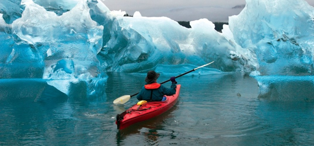 A kayaker amid sculpted iceberg in Tracy Arm Fjord. Credit: Ralph Lee Hopkins
