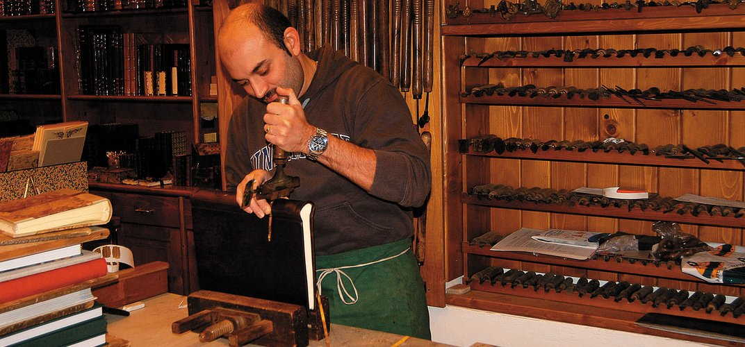 A leather artisan at work