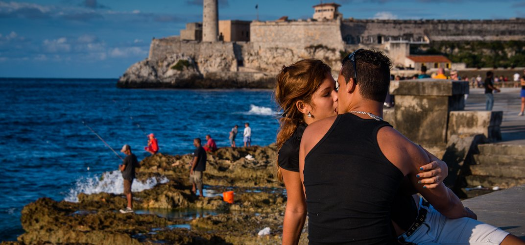 """Malecón, called """"lover's boulevard"""" by the locals, stretching for four miles along Havana's north coast. Credit: Jia Han Dong"""