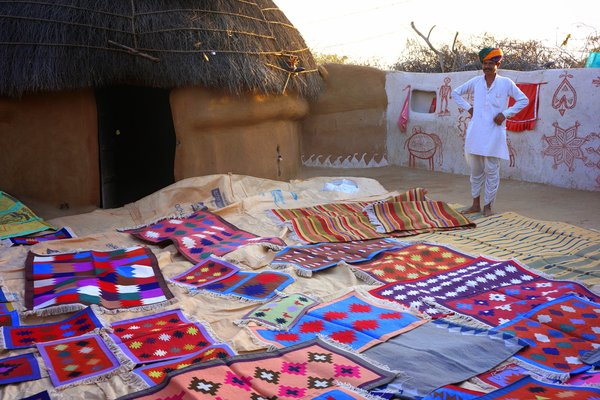 Rug weaver with his wares (Doranne Jacobson)