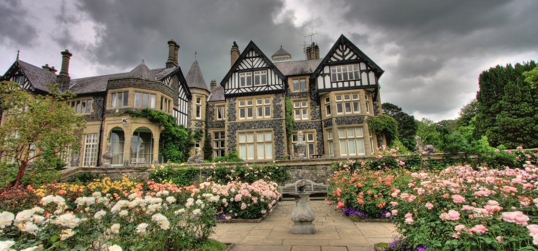 The formal rose garden and manor house at Bodnant Gardens