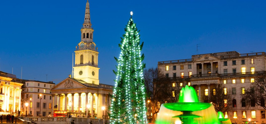 Trafalgar Square decorated for the Christmas holiday, with St. Martin in the Fields in the background