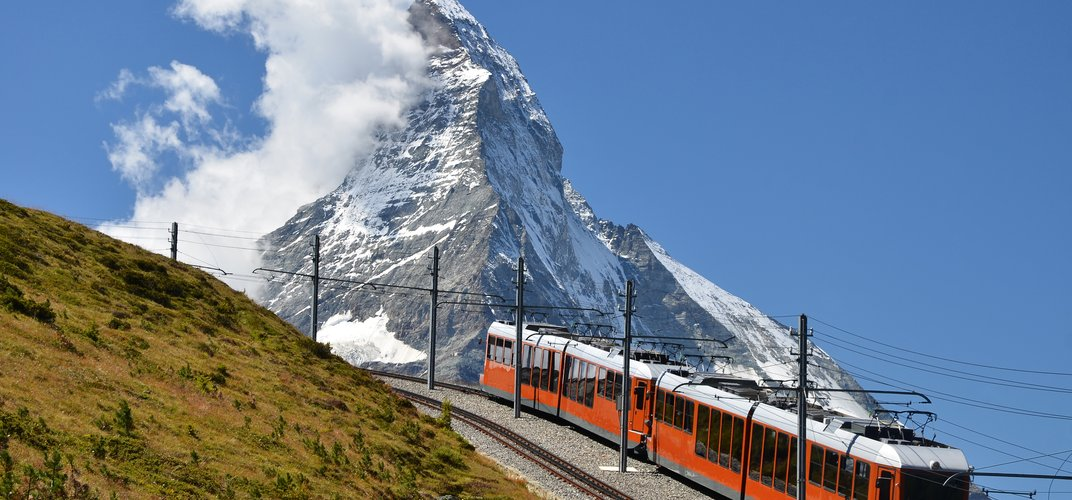 The famous <i>Gornergrat Bahn</i>, the highest cog railway in Europe, with the profile of the Matterhorn